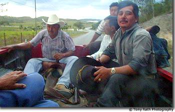 Mestizo workers in back of Mennonite pick up